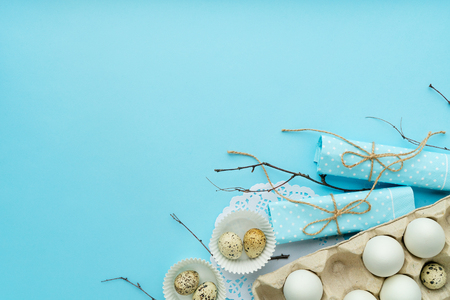 top view easter composition with free and copy space isolated on blue background
