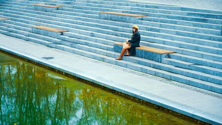 Depressed girl near lake in public park Banque d'images