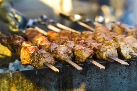 Barbecue with pork meat at grill party outside