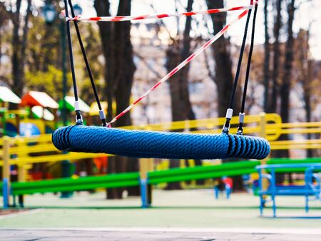 Lonesome swings on abandoned playground during covid pandemic