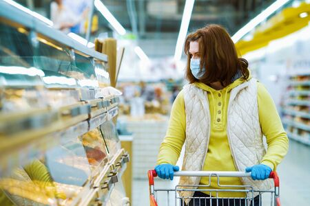 Girl choosing fresh bread at grocery store during pandemic