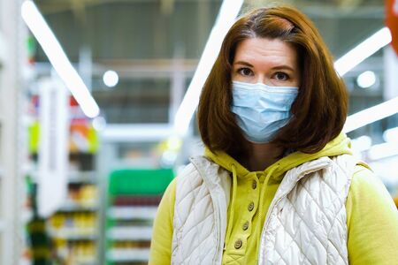 Girl in medical mask at grocery store during COVID pandemic
