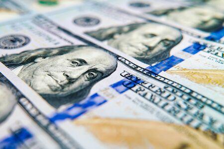Macro shot of US dollar bills lying in row