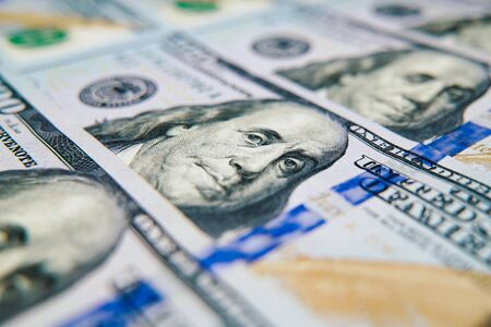 Macro of cash money in hundred dollar bills