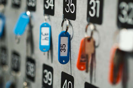Closeup stand of locker key at reception