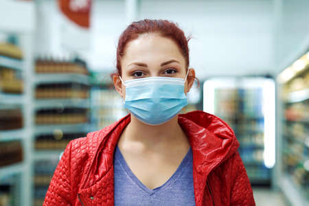 Woman in medical mask posing in mall