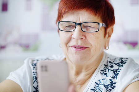 Senior woman having video call with family