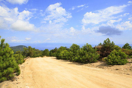sithonia: Dirt road in the mountains. Sithonia peninsula in northern Greece. Stock Photo
