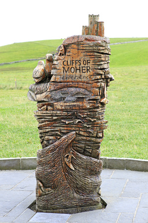 moher: Monument carved out wood. Cliffs of Moher the most famous landmark in Ireland. Stock Photo