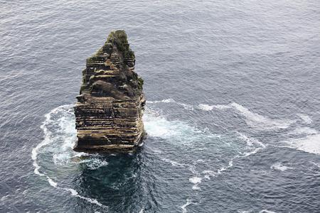 moher: Branaunmore sea stack in Atlantic Ocean. Cliffs of Moher the most famous landmark in Ireland.