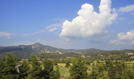 sithonia: Beautiful clouds over territory of Porto Carras Grand Resort. Sithonia. Stock Photo