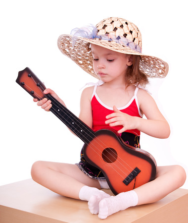 reverie: Girl in a straw hat with a guitar. Stock Photo