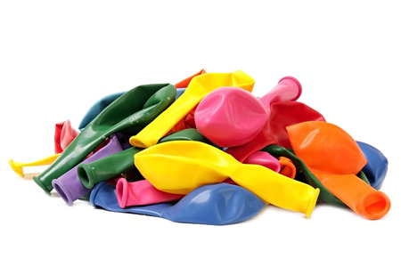 inflated: Coloured balloons. New not inflated. Isolated background. Stock Photo