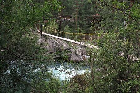 chemal: Suspended bridge for pedestrians. Mountain river of Chemal. Altai. Russia. Stock Photo