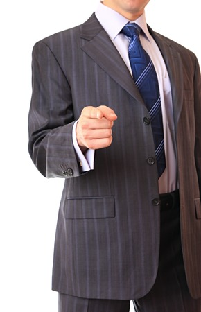 specifies: A businessman specifies a finger direction. Isolated background. Stock Photo