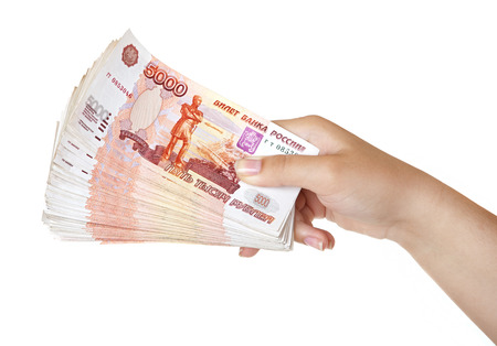 thousandth: Stack of five thousandth bills in the female hand. Stock Photo