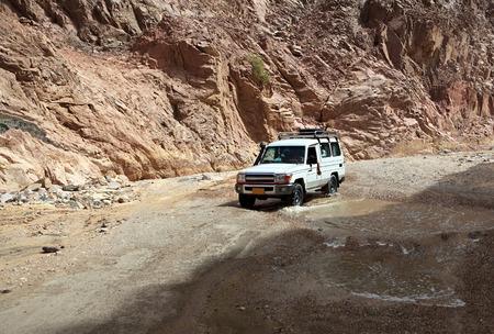 sinai: Truck rides on a mountain road. Mountains of Sinai. Egypt.