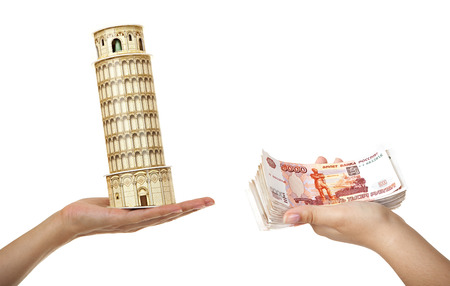 thousandth: Model Tower of Pisa and a pack of five thousandth of notes in womens hands. Stock Photo
