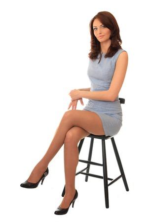 bar chair: Beautiful girl sitting on a bar chair.