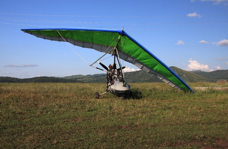 excursions: Hang-glider on a background mountains. Stock Photo