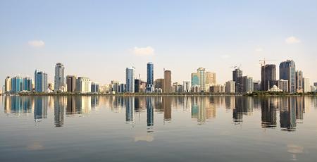 sharjah: Skyscrapers in Sharjah. Khalid Lagoon in the UAE. Stock Photo