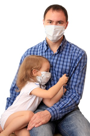 pity: Dad with daughter in non-permanent medical masks with a thermometer. Stock Photo