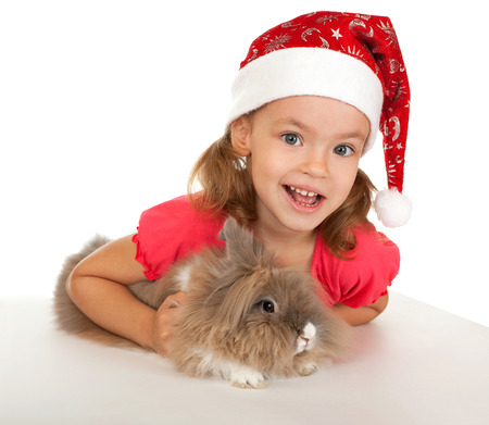lionhead: Child in the New Year hat with a rabbit. In the Oriental calendar 2011 - the year of rabbit.