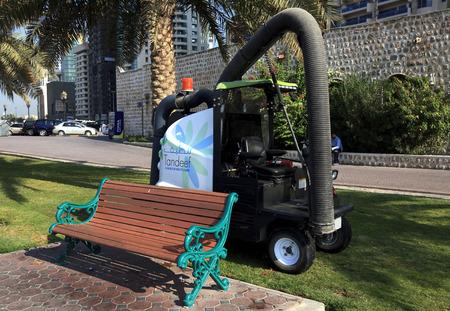 sharjah: Machine for cleaning debris on lawns and sidewalks. Sharjah. UAE.
