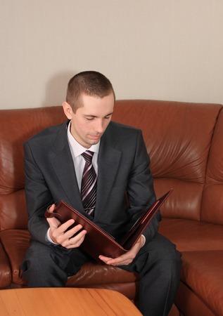 presentiment: A businessman studies an agreement in office.