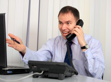 indignant: An indignant businessman sworn at by phone.