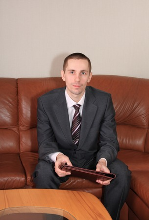 presentiment: Businessman with a business folder in expectant of reception.