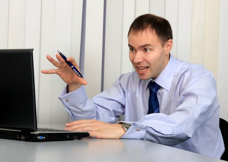 indignant: An indignant businessman looks in a notebook. Stock Photo
