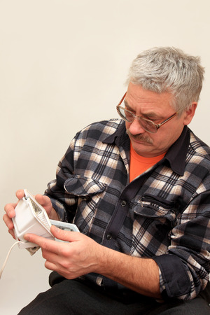 searchlight: A man tries to repair a searchlight.