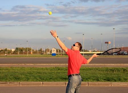 plays: A man plays large tennis.