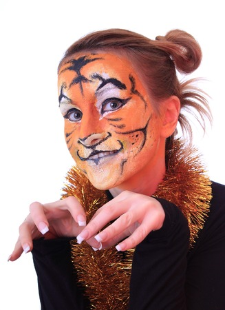 appearance: Girl in appearance a tiger. On an east calendar New 2010 year - year of tiger. Stock Photo