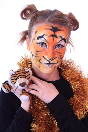 appearance: Girl in appearance a tiger with a toy tiger cub. On an east calendar New 2010 year - year of tiger.
