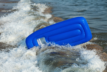 inverted: Inverted inflatable mattress in the sea wave.