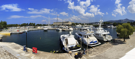 sithonia: Sithonia, Greece - July 20, 2014: Beautiful panorama of yachts and boats in the private dock. Porto Carras Grand Resort. Editorial