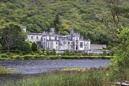 connemara: Connemara, Ireland - August 26, 2014: Kylemore Abbey on the lake. National park Connemara in Ireland.