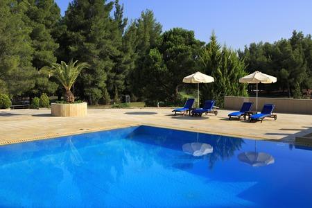 sithonia: Sithonia, Greece - July 18, 2014: Parasols by the pool Porto Carras Meliton. Sithonia.