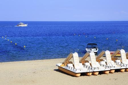 sithonia: Sithonia, Greece - July 20, 2014: Catamaran on beach sand. Porto Carras Sithonia. Editorial