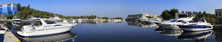 sithonia: Sithonia, Greece - July 18, 2014: Panorama of boats in the private dock. Porto Carras Grand Resort. Editorial