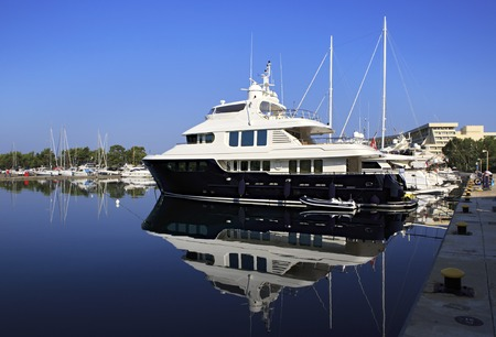 sithonia: Sithonia, Greece - July 18, 2014: Beautiful huge yacht at the dock. Largest private dock in northern Greece.