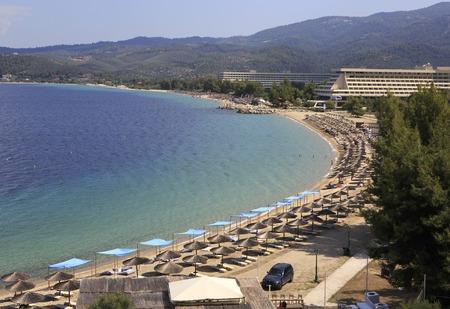 sithonia: Sithonia, Greece - July 20, 2014: Paid beach of Porto Carras Grand Resort. Sithonia. Editorial