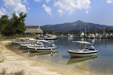 sithonia: Sithonia, Greece - July 20, 2014: Porto Carras Grand Resort. Motor boats at the dock.