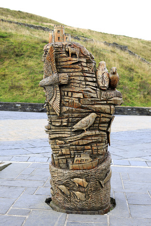 moher: Clare, Ireland - August 25, 2014: Monument carved out wood. Cliffs of Moher the most famous landmark in Ireland.