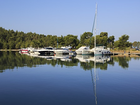 sithonia: Sithonia, Greece - July 18, 2014: Mirror view of yachts. Largest private dock in northern Greece.