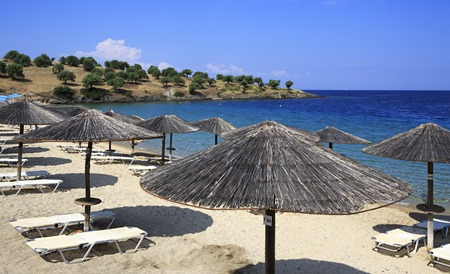 sithonia: Sithonia, Greece - July 20, 2014: Parasols of straw on the beach of Porto Carras Grand Resort.