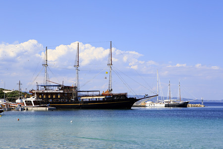 sithonia: Ormos Panagias, Greece - July 11, 2014: Ships in the harbor of Ormos Panagias in Sithonia Editorial