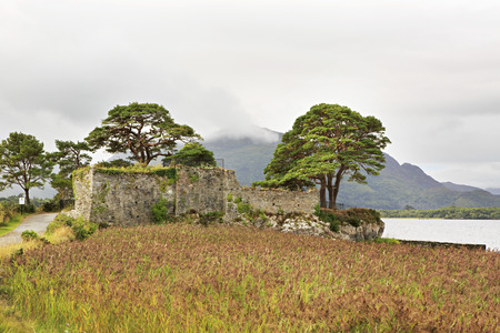 lough: Ruins of an ancient fortress on Lough Leane Lower Lake. View from Lake Hotel Killarney. Stock Photo